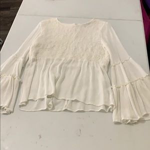 white long sleeve ruffled shirt